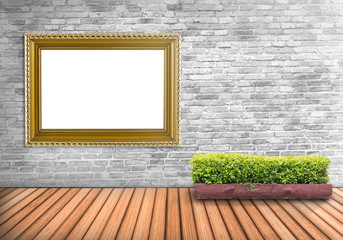 Blank frame bronze vintage on a concrete wall with tree pot on w