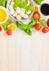 Tomatoes mozzarella salad making , ingredients .