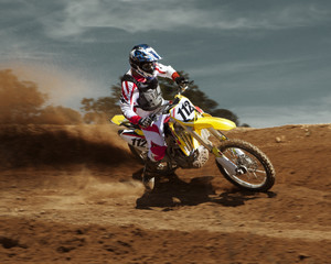 Caucasian dirt bike rider on course