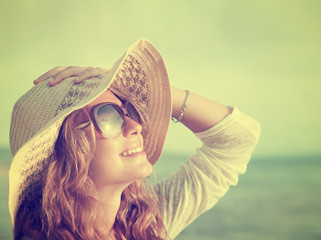 Happy woman relaxing at the beach. Summer vacations concept