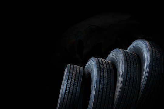 Car tires with alignment on white background