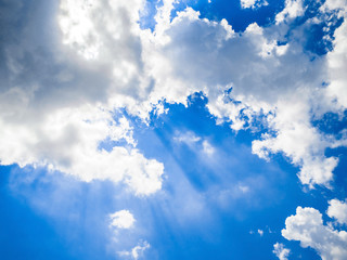 rays light blue sky clouds background