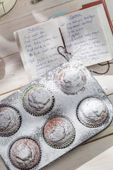 Decorating sweet muffins with caster sugar