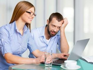 Laptop. Couple of freelancers enjoying some online things