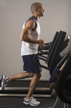 Hispanic man running on treadmill