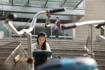Chinese student reading on campus