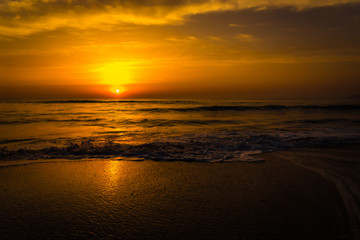 Golden sunrise sunset over the sea ocean waves