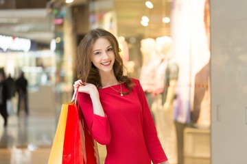 Retail. Young woman holding shopping bags