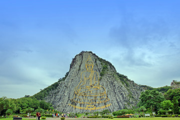 Touristic place in Thailand, Buddha made of gold on the rock