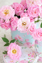 Beautiful fresh pink roses in a beautiful box .