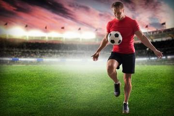Soccer. Professional soccer player kicking ball