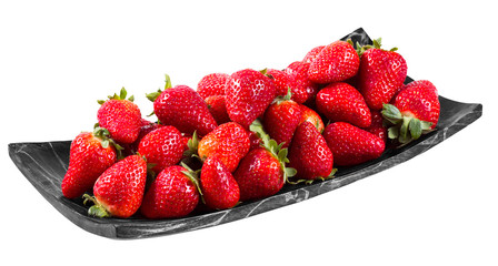 Tasty  strawberries freshly collected in a wooden plate isolated