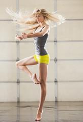 Caucasian dancer practicing in studio