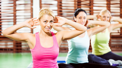 Young women exercising in gym