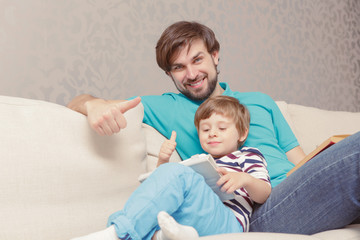 Father and son show thumbs up