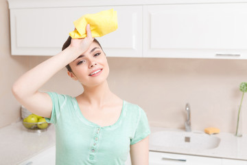 Youthful woman tired in kitchen