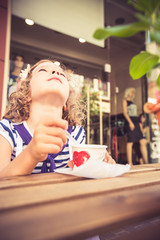 Happy child eating ice-cream