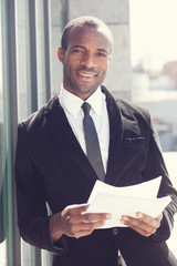 portrait of happy black man in business attire