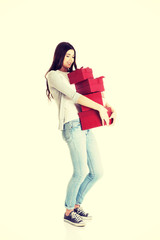 Teen holding presents