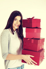 Teen holding presents