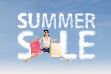 Woman make summer sale sign