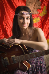 Romantic hippie style girl with guitar