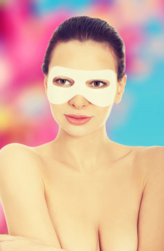 Young woman getting facial mask