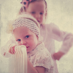 Portrait of beautiful little girls (sisters)  in vintage style.