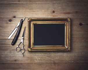 Black canvas with a frame and vintage barber tools