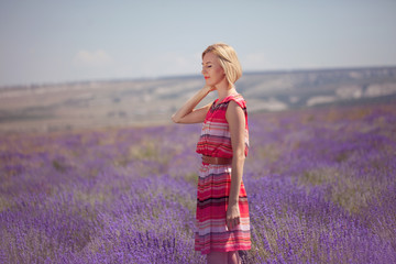 Young beautiful woman in a lavender field