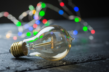 Vintage tungsten bulb with color lights
