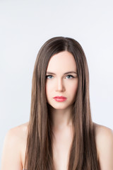 Brunette with long straight hair.