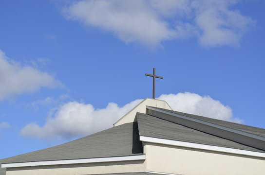 Modern Church roof and steeple with symbolic cross