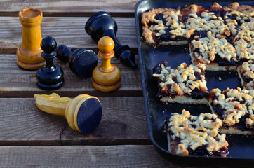 Plum pie and chess on the garden bench