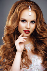 Portrait of Beautiful Woman. Long Red Hair and Fashion MakeUp