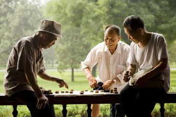Three men playing board game