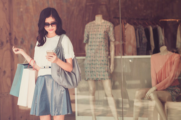 Girl at the shop window