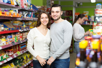 Happy couple in a supermarket