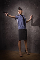 Woman police officer shooting with a pistol