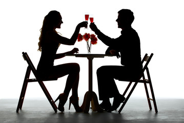 Couple Having Dinner With Wine Glass On Table