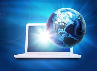 Earth model above laptop