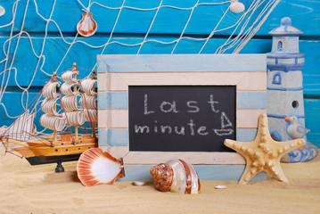 marine frame with last minute offer written on  blackboard