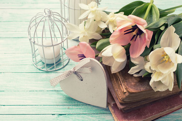 Background with fresh flowers, old books and candles