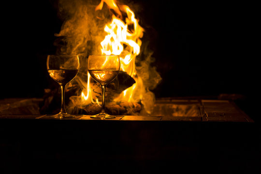 Two Wine Glasses Fire