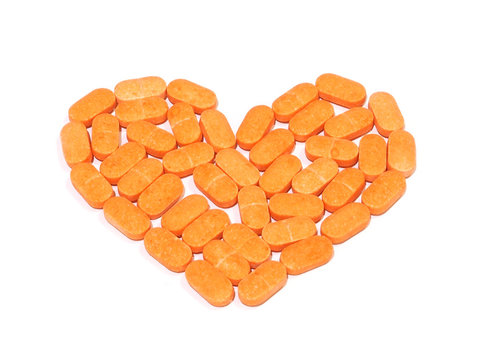 Pills of vitamin C on white background