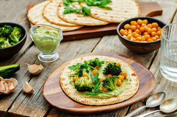 vegan tortilla with roasted broccoli and chickpeas and avocado s