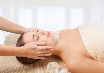 Spa. Young attractive woman getting spa treatment over white