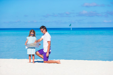 Young father and little girl during tropical vacation