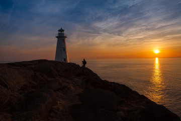 Photographer at Lighthouse at Ocean Sunrise