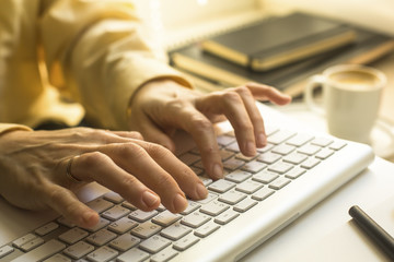 Woman office worker typing on the keyboard.
